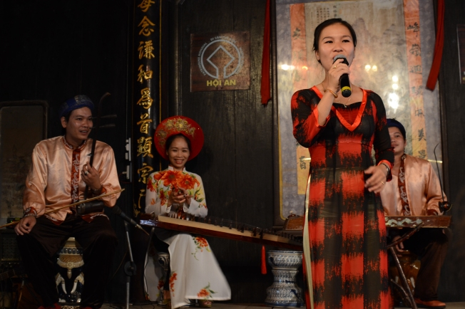 Operatic singing and traditionally dressed musicians