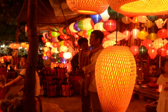 A lantern seller and his son at the night market